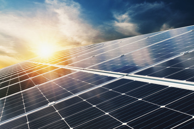 solar-panel-with-blue-sky-sunset-concept-clean-energy-electric-alternative-power-nature_34152-1985